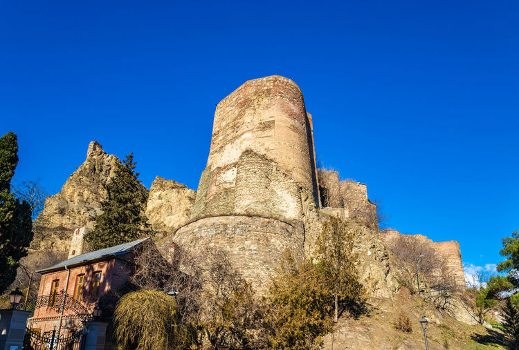 Low angle view of castle against clear blue sky