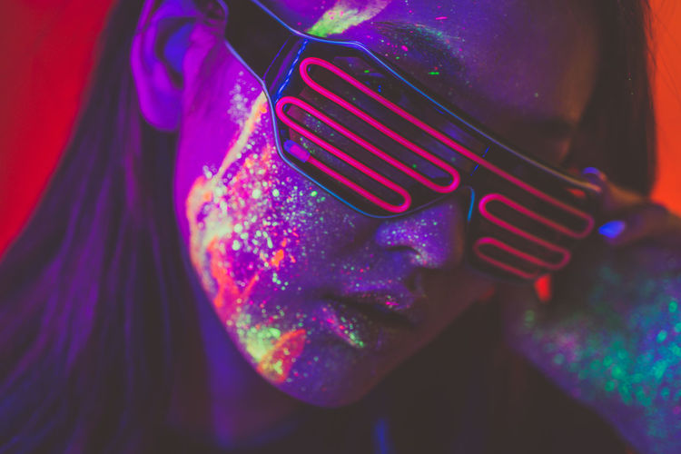 Close-up of woman wearing multi colored light painting