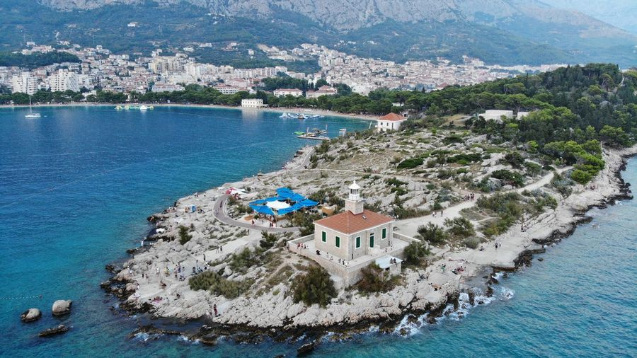 High Angle View Of Sea And Buildings