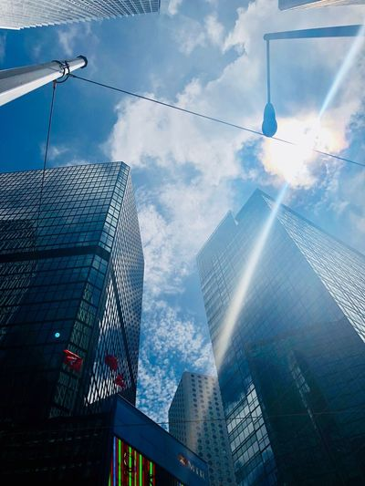 Skyscrapers and Sunshine HongKong Travel Destinations Built Structure Building Exterior Architecture City Building Office Building Exterior Sky Cloud - Sky Low Angle View Office Tall - High Skyscraper Modern No People Tower Glass - Material Development Day Reflection #urbanana: The Urban Playground