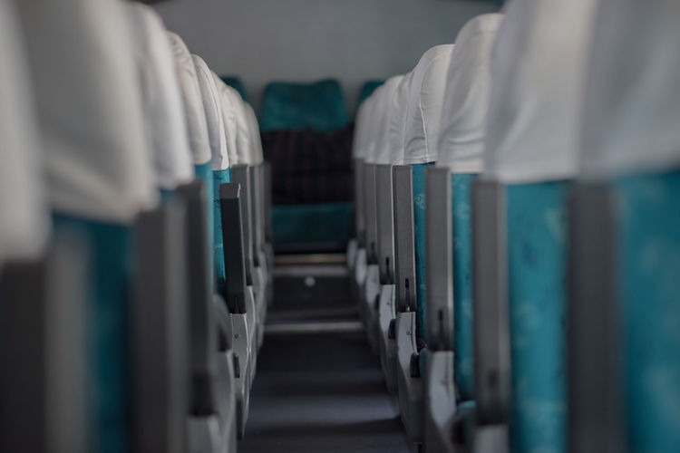 Close-up of empty seats inside bus