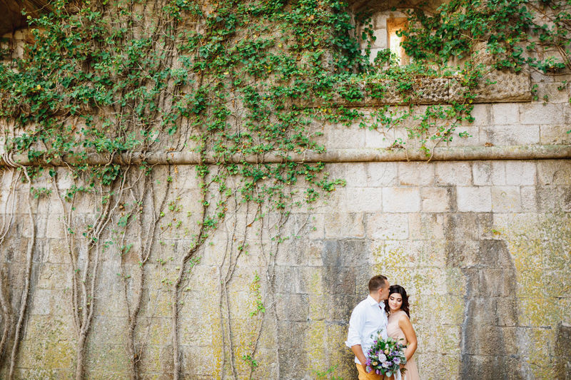 Couple standing near wall