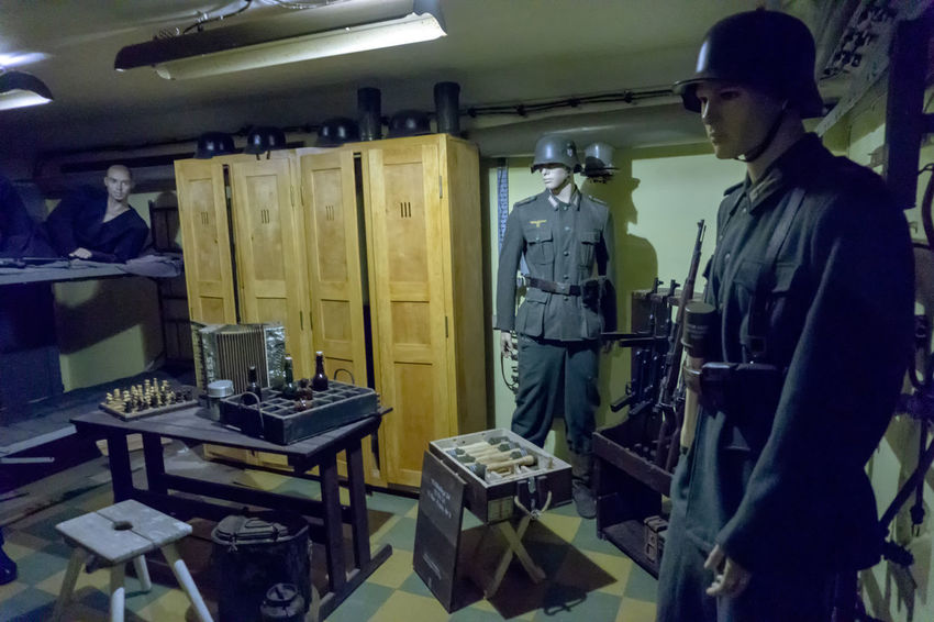 Underground city on the island of Wolin (Poland). A secret complex with a kilometer of tunnels connecting sub-base shelters in which the decision to atomize during the Third World War was to be made. Currently a museum. II World War Mannequins Soldiers Wehrmacht Cantonment Clothing Craft Equipment History Human Representations Illuminated Indoors  Military Military Uniform Standing Table