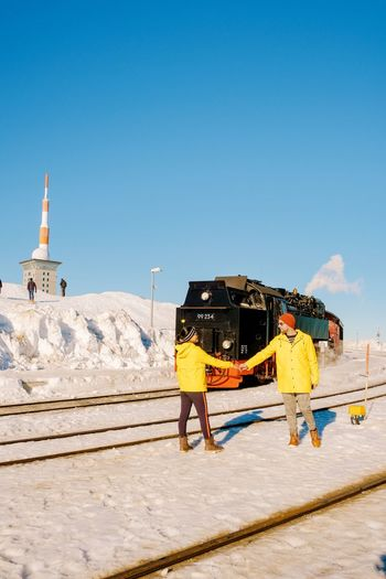 Brocken Brockenbahn Men Women Couples Valentine Harz Harzmountains Harz Mountains, Germany Train Steam Train Man White Snow Raincoat Working Blue Clear Sky Sky Snowcapped Mountain Cold Temperature Covering Deep Snow Frozen Snowfall Winter Snow Covered Cold Snowcapped