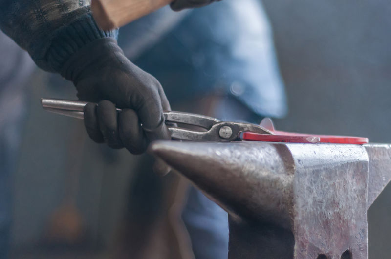 Alloy Blacksmith  Business Close-up Finger Focus On Foreground Hand Hand Tool Holding Human Body Part Human Hand Indoors  Mechanic Men Metal Metal Industry Occupation People Skill  Steel Tool Work Tool Working