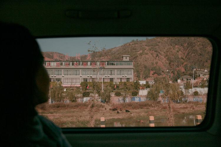 City seen through car window