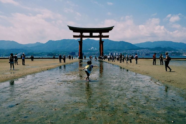 Architecture Beach Built Structure Crowd Day Group Of People Large Group Of People Leisure Activity Lifestyles Men Mountain Nature Outdoors Real People Sky Travel Travel Destinations Water Women