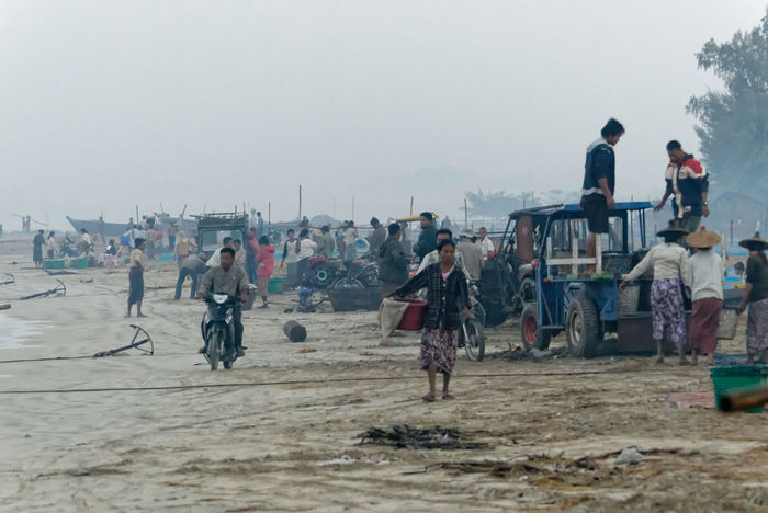 This shot gives and idea about the fish market on the beach. In the meantime they rolled in a bit of transportation machinery Fishing Village Rakhine State Beach Clear Sky Day Full Length Large Group Of People Lifestyles Men Myanmar Nature Outdoors People Real People Sand Sky