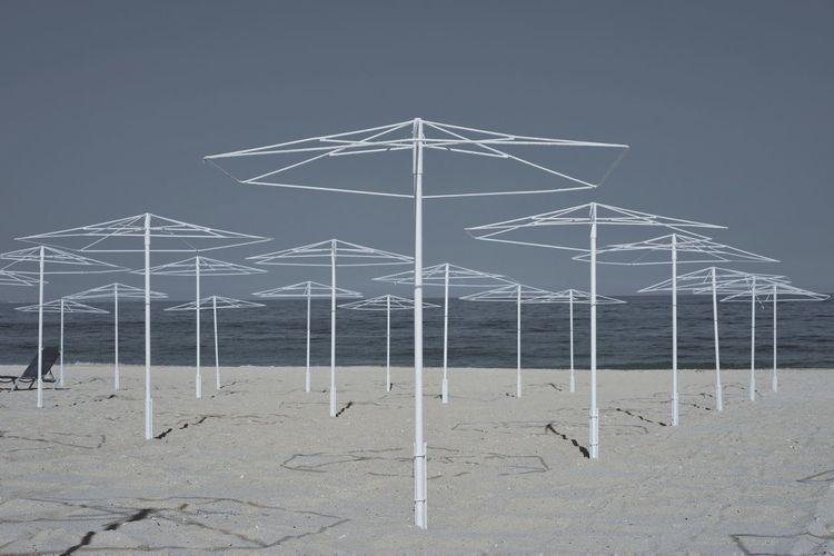 Beach Umbrellas At Beach Against Clear Sky During Sunny Day