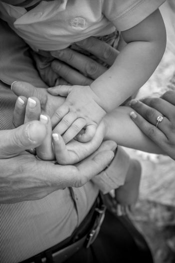 Close-up of family stacking hands