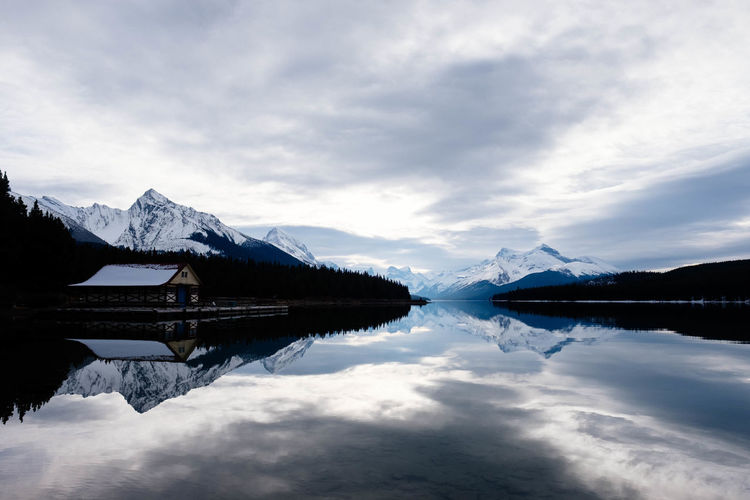 Reflection Water Tranquility Scenics - Nature Sky Mountain Cloud - Sky Tranquil Scene Cold Temperature Snow Beauty In Nature Winter Lake Nature Mountain Range Waterfront Symmetry Snowcapped Mountain No People Outdoors Reflection Lake