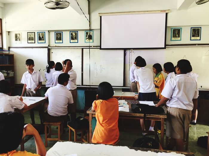 Classroom in Thailand Group Of People Real People Men People Group Crowd Adult Classroom Education Uniform Standing Table Lifestyles Learning Student Women Sitting
