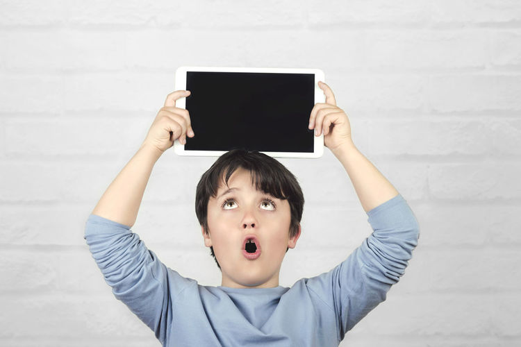 Child Portrait Technology Wireless Technology Leisure Activity Communication Screen Tablet Digital Computer Student Happy Internet Happiness Concept Surprised Cyber Space Fun Funny Education Lifestyle Connection Learning Imagination Entertainment