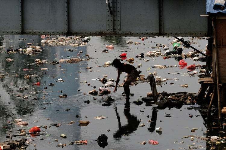Man standing in polluted water