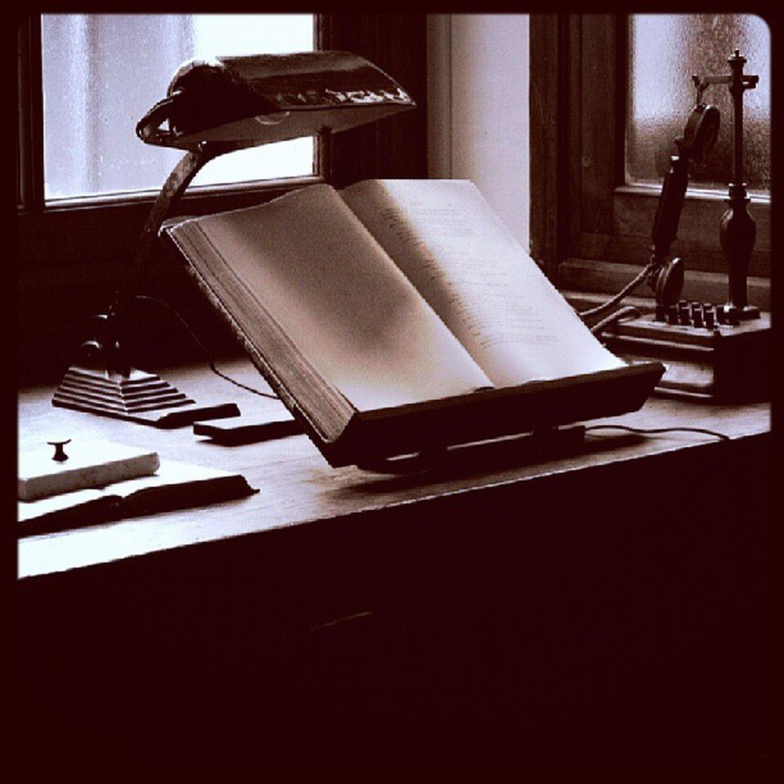 indoors, transfer print, table, auto post production filter, absence, communication, empty, chair, no people, still life, shadow, sunlight, paper, technology, day, close-up, wood - material, text, book, high angle view
