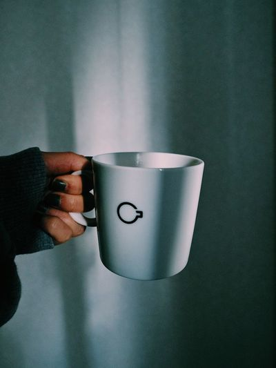 Human Hand Hand Human Body Part One Person Holding Body Part Mug Cup Coffee Cup Coffee - Drink Finger Indoors  Food And Drink Lifestyles Coffee Drink Wall - Building Feature Human Finger Close-up Human Limb