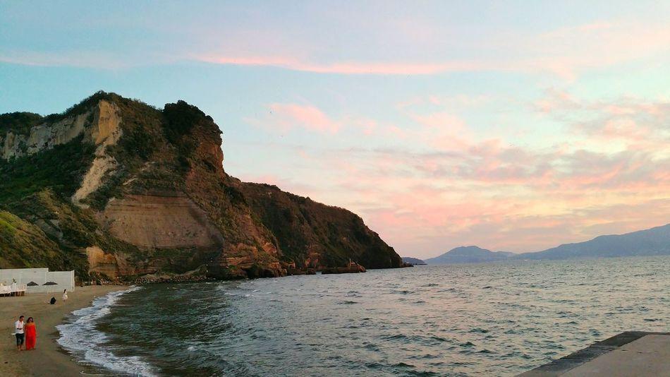 Napoli Beach Sea Sand Coastline Rock - Object Landscape Outdoors Sunset Lacittapiubelladelmondo Lovecity  City Landscape Peopleinlove