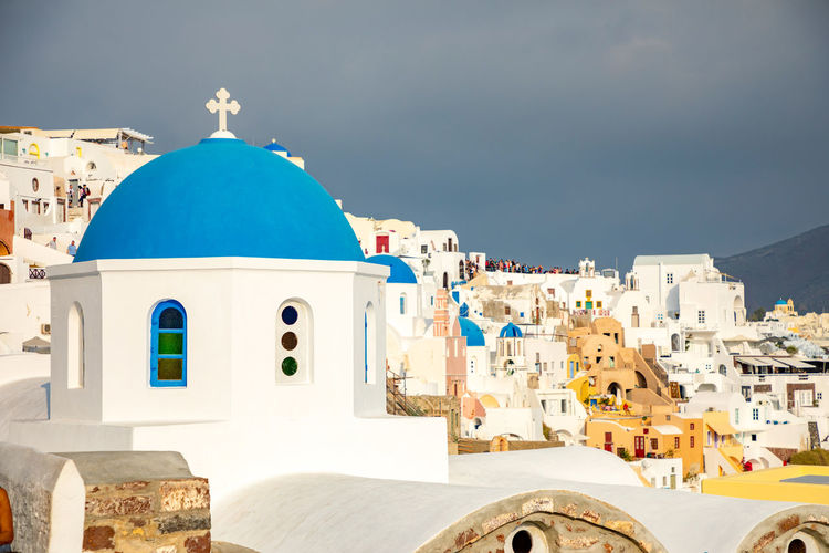 Greece Santorini Oia Thira Architecture Building Exterior Built Structure Religion Belief Place Of Worship Building Spirituality Dome Sky Nature Sunlight City Blue Travel Destinations Whitewashed Travel No People Outdoors