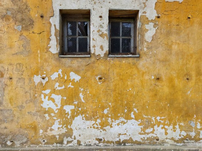Yellow Window Full Frame Backgrounds Architecture Building Exterior Close-up Built Structure Peeled Run-down Peeling Off Worn Out Damaged Abandoned Rusty Wall Painted Bad Condition Deterioration