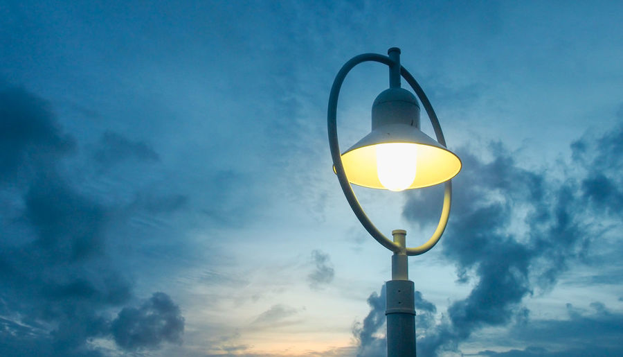 Street light when sun set Bright Blue Bulb Decoration Electric Lamp Electric Light Illuminated Lamp Light Lighting Equipment Low Angle View Nature No People Outdoors Sky Street Light Sunset