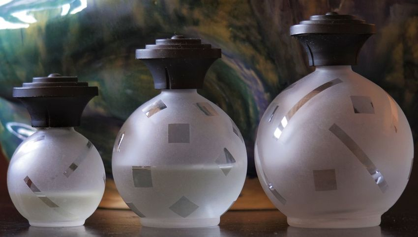 A little artsy fartsy and contrived but pretty cool anyway. Bottles Pottery In A Row Contrived Artsy Fartsy