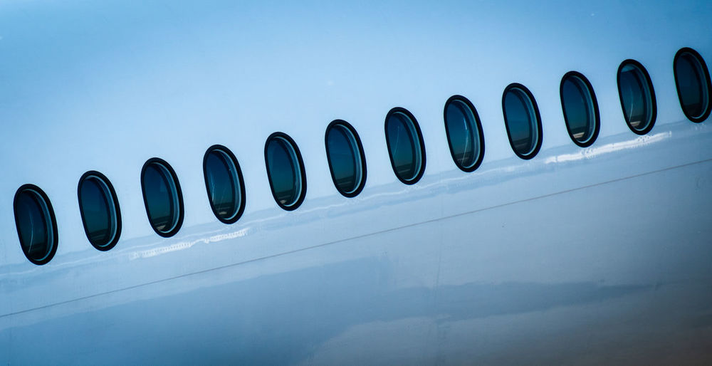 Aeroplane Plane Public Transportation Transportation Travel Traveling Aerospace Industry Aircraft Airplane Airport Blue Close-up Copy Space In A Row Metal Mode Of Transportation No People Pattern Public Transport Repetition Shape Side By Side Windows