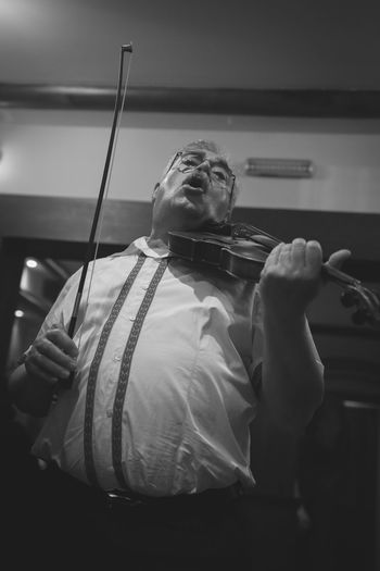 Musician playin violin. Acoustic Band Black And White Close-up Country Music Holding Live Event Live Music Music Musical Instrument Musician Musicians One Person Performance Playing Music Strings Violin Virtuous