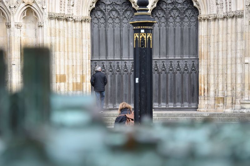 Lost In The Landscape EyeEm Selects Architecture Real People Religion Built Structure Architectural Column Place Of Worship Men Spirituality Building Exterior Lifestyles Women Day Outdoors City One Person Adult People Historical Building York Minster  People And Places EyeEm Masterclass Nikon EyeEm