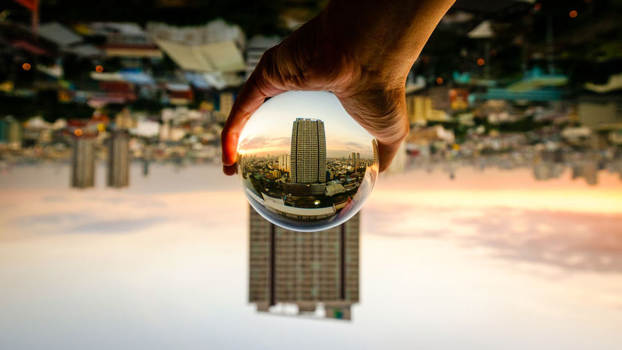 Grabbing the city Architecture Building Exterior City City Cityscape Creative Crystal Ball Human Hand Men Outdoors Unique Unique Perspectives 10