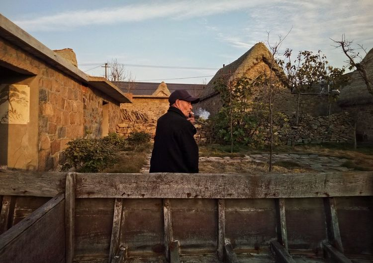 Chinese Old Man Phone Photography Street Photography PhonePhotography Streetphotography One Man Only Human Body Part Building Structures Light And Shadow Sunlight Tree Standing Rear View Sky Architecture Autumn Mood