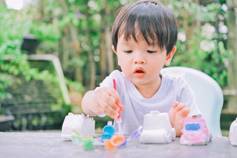 Portrait of cute boy holding ice cream