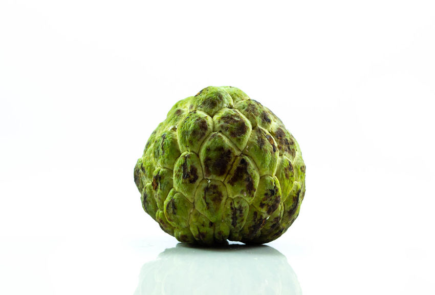 Sugar apple half isolated on white background Exotic Apple; Close-up Custard; Delicious; Food Freshness Freshness; Fruit; Healthy Eating Nutritious; Ripe; Red; Grape; Crop; Vineyard; Fruit; Agriculture; Vine; Cabernet; Leaf; Plant; Green; Purple; Bunch; Blue; Cultivated; Nature; Autumn; Food; Wine Round; Sugar; Group; Marshmallow; Sweet; Candy; Tasty; Snack; Background; Twist; Soft; Food; Pastel; Pink; Colorful; Confection; Dessert; Delicious; Yellow; White; Fluffy; Pattern; Treat; Unhealthy; Closeup; Pile; Yummy; Sugary; Sticky; Gummy; Fun; Blue; Light;  Tasty; White Background