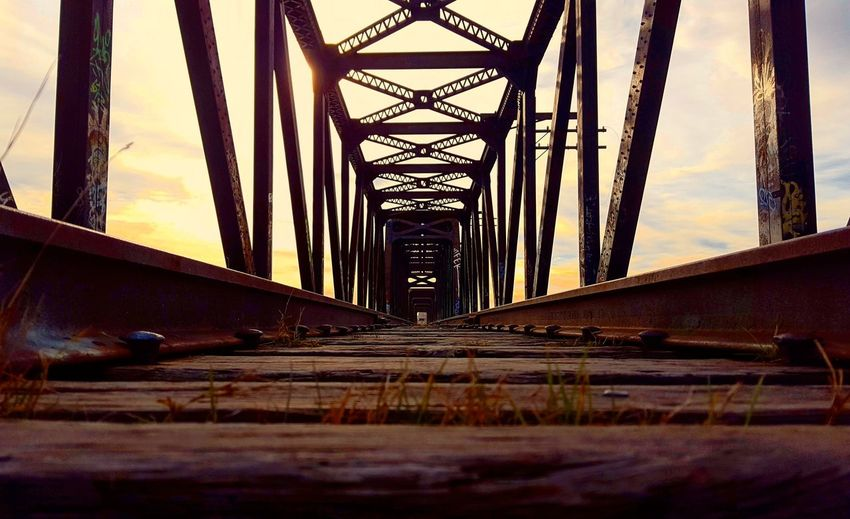 Sun rise over the bridge Railroad Railroadbridge Bridge Lowangleview Morning Day Morning Orange Sky Outdoors City Urban Alone No People Androidography Shot with Galaxys6