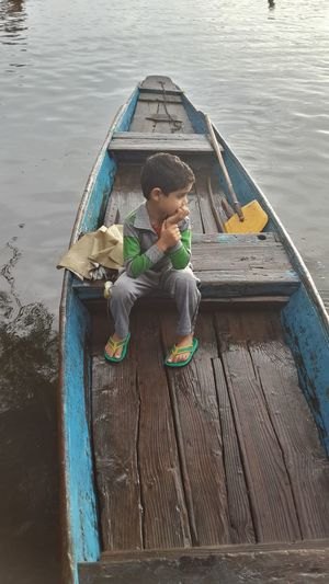 Boy Casual Clothing Childhood Escapism Full Length Hanging Kashmiri Boy Leisure Activity Lifestyles Low Section Men Occupation Real People Relaxation Shikara Sitting Standing Swing Vacation Weekend Activities Women This Is Masculinity