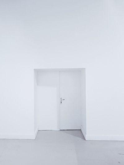 Closed doors in white building