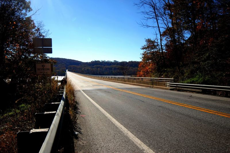 View from Norman wood bridge in the fall Autumn Fall Tree Transportation Road Plant Sign Symbol Marking Direction Road Marking Sky Nature The Way Forward No People Diminishing Perspective Day Sunlight vanishing point Street Clear Sky