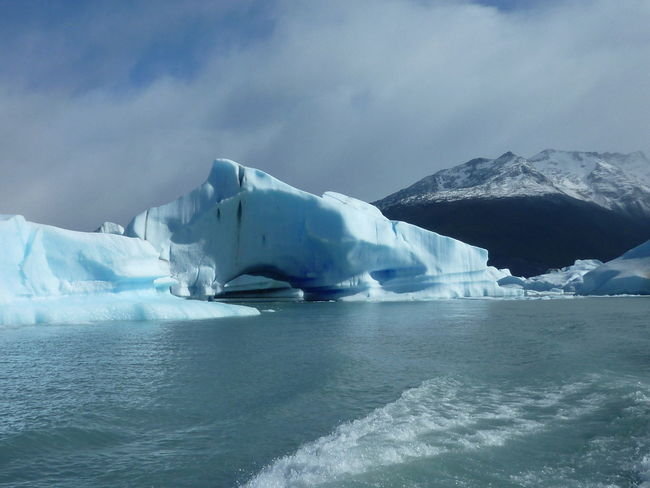 Beauty In Nature Cloud - Sky Cold Temperature Day Floating On Water Frozen Glacier Ice Iceberg Iceberg - Ice Formation Idyllic Nature No People Outdoors Polar Climate Scenics Sea Sky Tranquil Scene Tranquility Water Winter