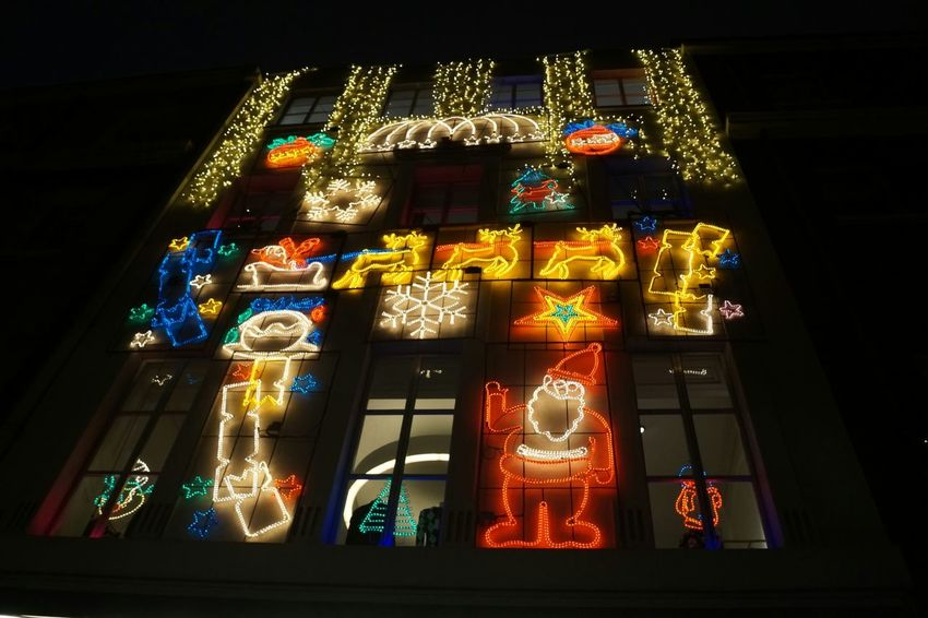 Christmas by Kezno Citybynight Loveit Visiting Mylondon My Point Of View Advertisement Sonyalpha Sony My Photography Kenzo Illuminated Decoration Christmas Decoration No People Night Celebration Low Angle View Multi Colored Black Background Architecture Christmas Shades Of Winter