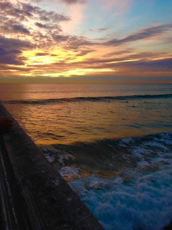 The pier Waiting To Catch A Wave Sea At Night Sea And Sky Wood - Material Wave Crystal Pier Sunset Ocean View