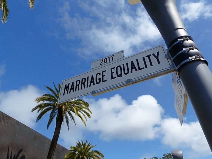 """Low angle view of street sign saying """"marriage equality"""""""