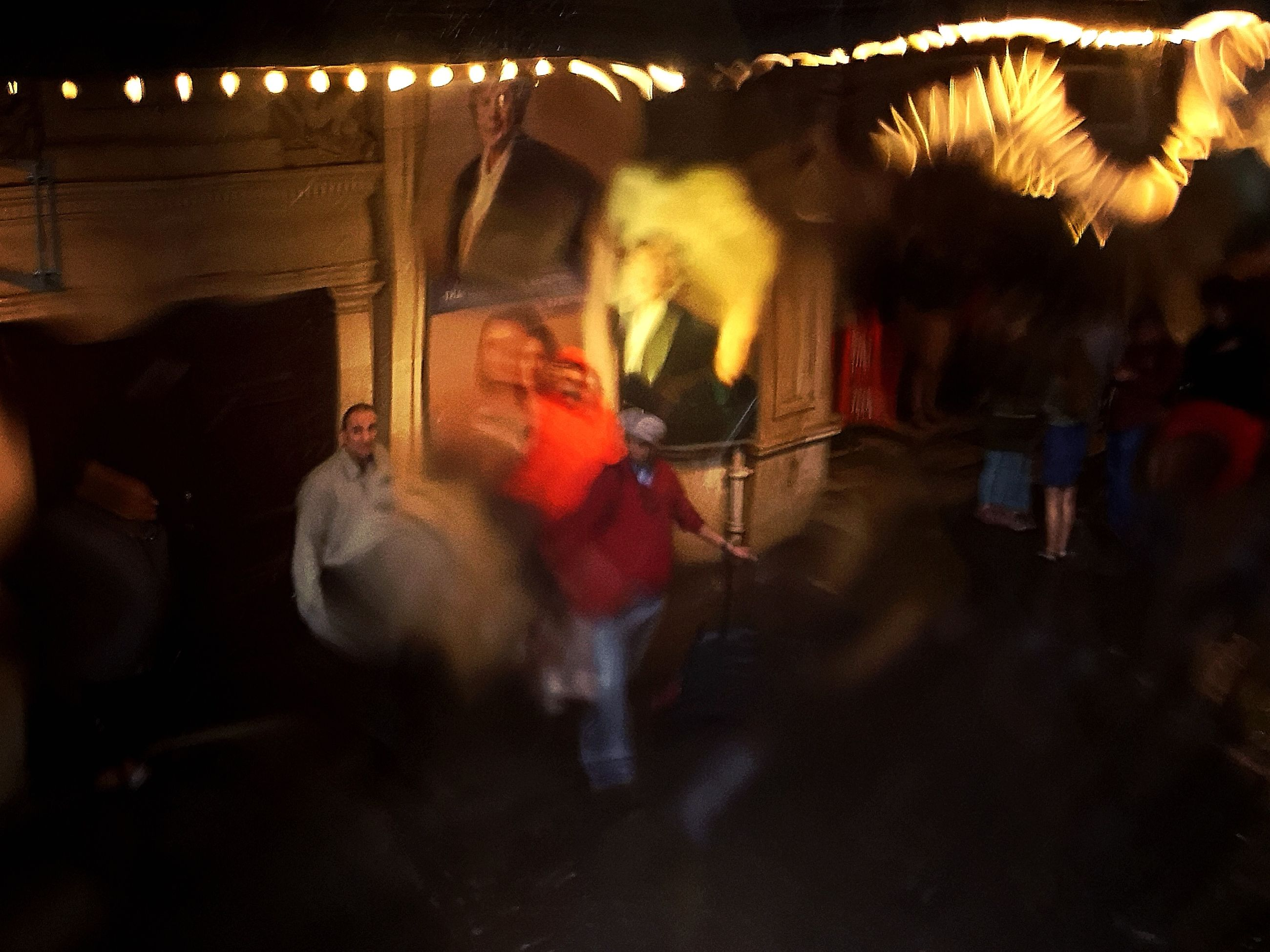 night, real people, blurred motion, arts culture and entertainment, men, motion, illuminated, people, incidental people, street, performance, event, musical instrument, group of people, celebration, unrecognizable person, music, adult, musician