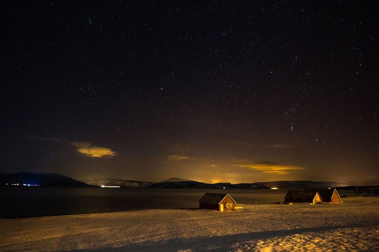 Cold night in Vangshamn on Senja  Astronomy Atmosphere Boathouse Clear Sky Cold Dark Illuminated Landscape Mountain Range Nature Night Night Lights Northern Norway Sea Shore Sky Snow Space Star - Space Starry Sky Stars Water Winter