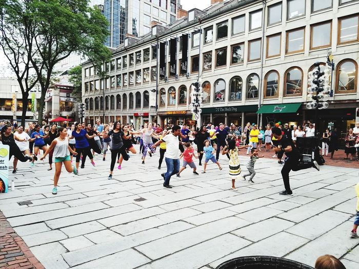 Bollywood Dancer At Work  Bollywooddance Bollywood Music Dance Fitness Fitness Can Be Fun Having A Great Time Outdoor Fitness All Ages Boston, Massachusetts Dancing In The Street Architecture Building Exterior Large Group Of People City Day Outdoors Real People Men Women People Children Sky Having Fun Cityscape The Week On EyeEm