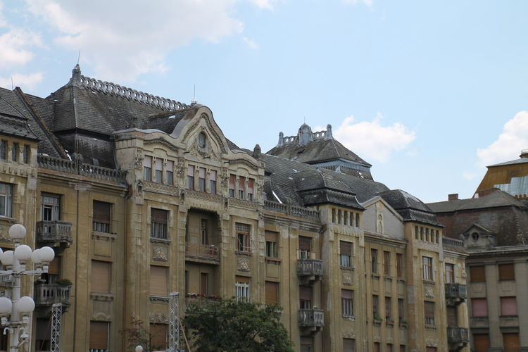 Architecture Balcony Building Building Exterior Built Structure City Cloud Cloud - Sky Day Exterior Façade History Low Angle View No People Outdoors Residential Building Residential Structure Sky Sunlight Window Timisoara