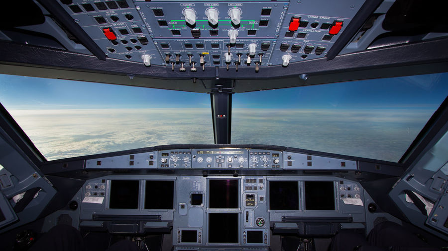 Cloudscape seen through airplane windshield