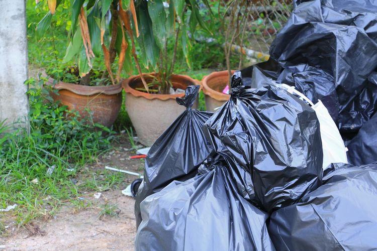 Pile black garbage bag roadside in the city Bin, Black, Plastic Bag Road Rubbish Stack Bag, City, Dirty Dregs Dump; Ecology Environment; Garbage Heap Junk; Midden Pile; Pollute; Road; Rubbish Collection Rubbish; Trashcan Trashcan; Trashcanart