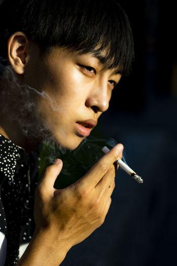Close-up of woman smoking cigarette