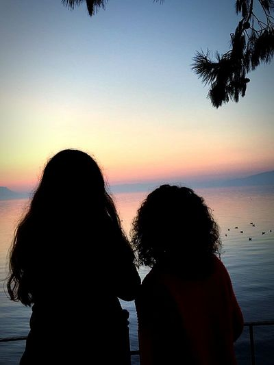 Sunset Women Nature Two People Sea Beach Togetherness Headshot Vacations Rear View Horizon Over Water Silhouette Friendship People Adult Outdoors Sky Close-up Adults Only Day