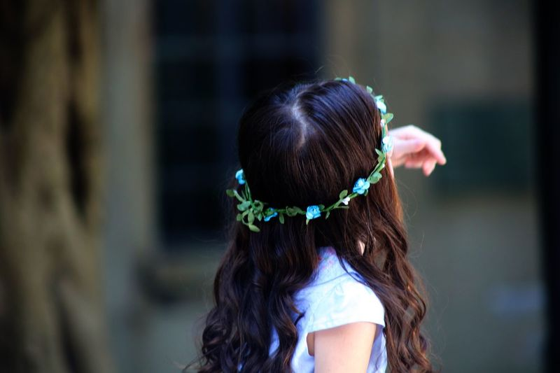 Rear View Of Girl Wearing Wreath