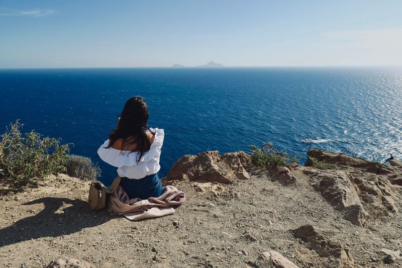 🌊 Sitting One Person Sea Horizon Over Water Horizon Scenics - Nature Water Leisure Activity Real People Nature Adult Sunlight Beauty In Nature Beach Outdoors Hairstyle Sky Lifestyles Women Land EyeEmNewHere EyeEmNewHere EyeEmNewHere EyeEmNewHere